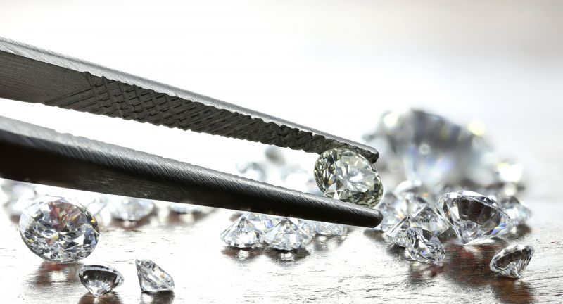 diamond, cut diamonds, brilliant, polished, cut, diamond trade, diamond dealer, smoothed, brilliant cut, precious, stone, gem, gemstone, gems, gemstones, carat, sorting, selecting, selection, jeweler, diamond cutting, diamond cutters, investment, luxury, rich, wealth, mining, mine, diamond mine, inflation, antwerp, commodities, value, certify, certification, attestation, treasure, goldsmith, goldsmiths, asset, assets, mineral resources, wooden background, wooden table, wooden boards, tweezers, tweezer, several, group