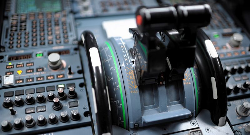 Aerospace Industry, Air Vehicle, Airbus, Airbus A320, Airplane, Cockpit, Color Image, Commercial Airplane, Computer Monitor, Contemporary, Electronics Industry, Horizontal, Image, Lever, Mode of Transport, Nobody, Photography, Technology, Throttle, Thrust Lever, Thrust Lever, Transportation, Travel, thrust