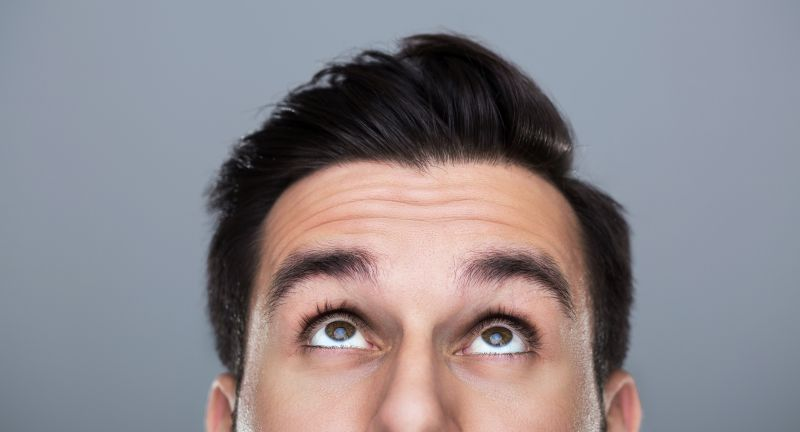 grey background, studio shot, man, people, young adults, one person, adult, caucasian, male, alone, attractive, handsome, looking, up, looking up, eyes, face, closeup